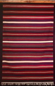 A seven band Rio Grande Blanket woven by Irvin Trujillo