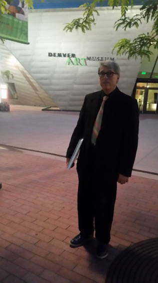 Irvin Trujillo in front of the Denver Art Museum on the night of the opening.