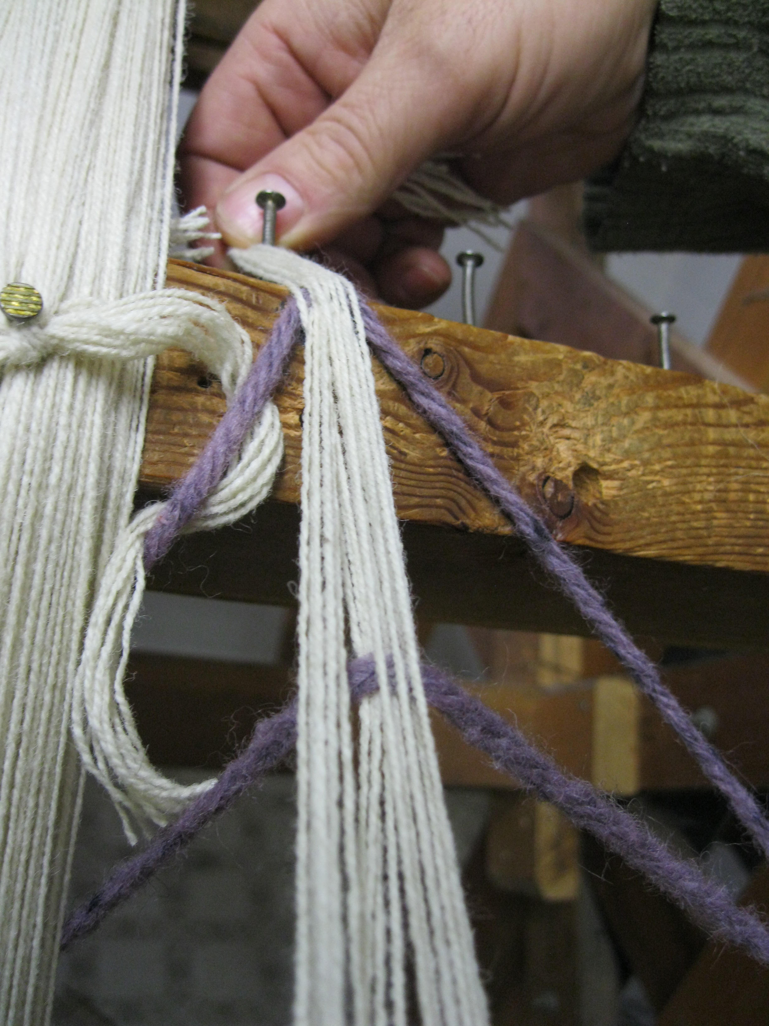 placing-the-beginning-of-section-on-nail-in-warping-mill
